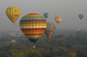 Balloons at Sunrise in the Skies over Chiang Mai at Balloon Festival